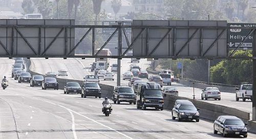 A funeral procession for the late pop star Michael Jackson makes it way along the Pasadena freeway 110 in downtown Los Angeles on it's way to a memorial service at the Staples Center on Tuesday. -AP Photo/Richard Vogel - 8 July, 2009