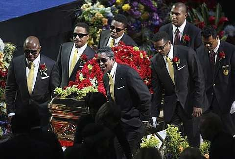 The Jackson brothers, from back left, Randy Jackson, Marlon Jackson and Tito Jackson, and from front left, Jermaine Jackson and Jackie Jackson carry the casket at the memorial service for the late pop star Michael Jackson in Los Angeles on Tuesday, July 7, 2009.-AP - 8 July, 2009