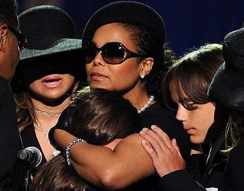 Janet Jackson, center, comforts her niece Paris Jackson as LaToya Jackson, left, and Prince Michael look on at the memorial service for Michael Jackson at the Staples Center in Los Angeles on Thursday, July 7, 2009.-AP - 8 July, 2009