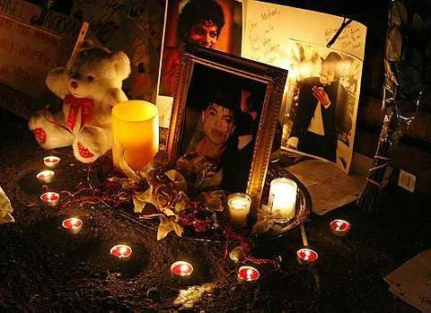 Candles light a makeshift memorial for Michael Jackson outside the Jackson family home in the Encino area of Los Angeles on Tuesday, July 7, 2009. - AP - 7 July, 2009