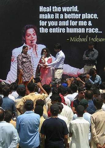 A local musician sings a Michael Jackson song during a ceremony to pay tribute to the late entertainer. - 29 June, 2009