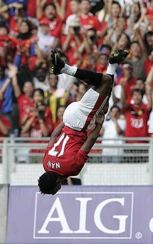 Manchester United's Nani celebrates after he scored a goal during a friendly match against Malaysia XI at Bukit Jalil National Stadium in Kuala Lumpur, Malaysia, Saturday, July 18, 2009. - AP - 18 July, 2009